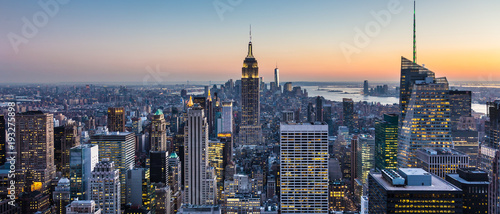 New York City. Manhattan downtown skyline with illuminated Empire State Building and skyscrapers at dusk. USA. - 193275898