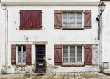 Dilapidated house facade in Brittany, France - 193276049