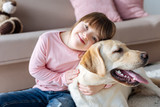 Child with down syndrome cuddling with dog - 193278037