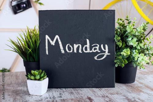 Motivational text on a blackboard. Monday.