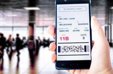 Electronic boarding pass on the screen of smartphone. Concept of modern travel. Boarding pass is fake