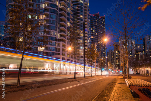 Zdjęcie XXL Night View of a Deserted Bicycle Lane with Light Trail Left by a Tram Passing by in Downtown Toronto
