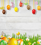 Idyllic spring meadow with Easter eggs and butterflies - 193294837