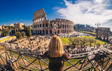 Female traveler watching over the Colosseum in Rome, Italy
