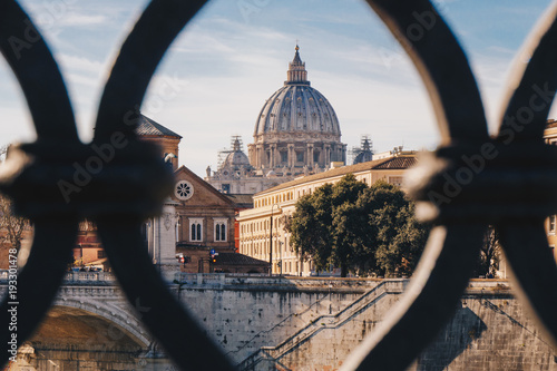 Basilica St. Peter in Vatican as seen from Sant' Angelo Bridge in Rome, Italy. Focus on the Basilica