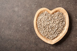 Sunflower seeds in heart shaped bowl - 193303040