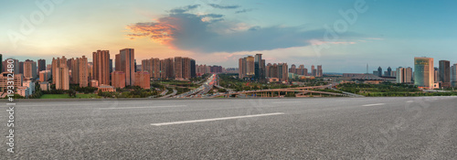 empty asphalt road and modern buildings in Zhengzhou east new district at twilight - 193312480