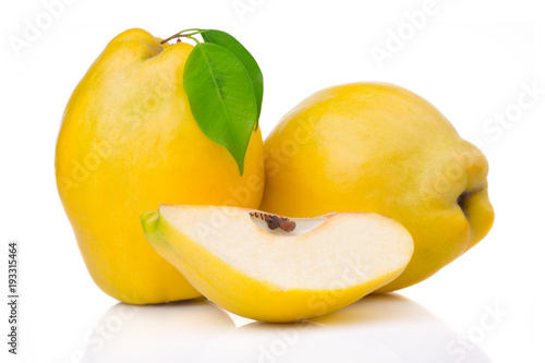 Ripe quince fruits with leaf and slice isolated on white