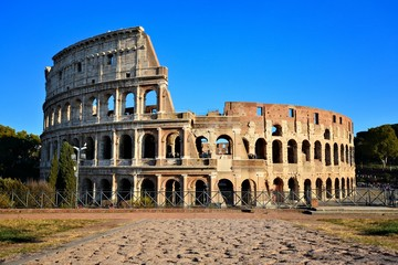 Rome, Italy, the Coliseum. View from Forum with ancient stone road.