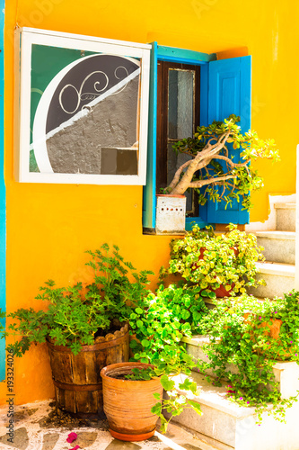 Plexiglas Freesurf Charming floral colorful streets of old town in Naxos island. Greece