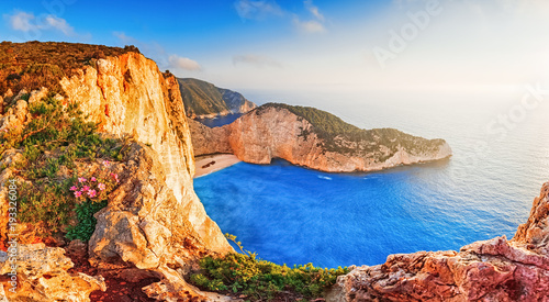 In de dag Schipbreuk Greece. Epic sunset scenery of Zate island, full name is Zakynthos - popular summer resort and European travel destination in Greece. Picturesque Navagio beach panorama with shipwreck landmark.