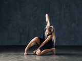 Young beautiful female dancer is posing in the studio - 193345806
