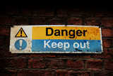Danger, Keep out sign on a brick wall