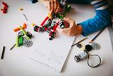 little boy building robot at robotic technology school lesson - 193383473