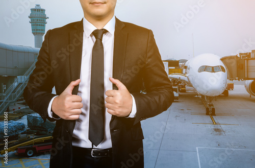 business man the passenger flight at the airport, background is run way and airplane.
