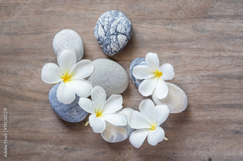 Plexiglas Plumeria frangipani flower and stone zen spa on wood