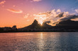 Quadro Sunset over mountains in Rio de Janeiro with water reflection and light leak, Brazil