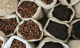 Fototapety Roasted coffee beans and grinded coffee