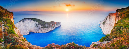 Fotobehang Schipbreuk Greece. Epic sunset scenery of Zate island, full name is Zakynthos - popular summer resort and European travel destination in Greece. Picturesque Navagio beach panorama with shipwreck landmark.