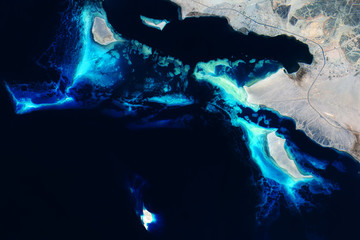 Coral reefs in the Red Sea off the coast of Saudi Arabia seen from space - Modified elements of this image furnished by ESA