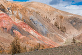 View of the red mountains and hills, the Martian landscape of Kyzyl-Chin. Travel to the national Park in the Altai mountains.