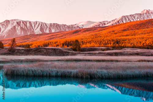 Plexiglas Lavendel Mirror surface of the lake in the mountain valley. The peaks of the cliffs on the horizon at the colorful sky. Autumn weather