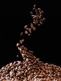 falling coffee beans on pile isolated on black - 193419282