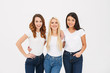 Portrait of three cheerful casual girls standing together
