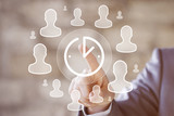 Businessman presses button clock web time cooperation network