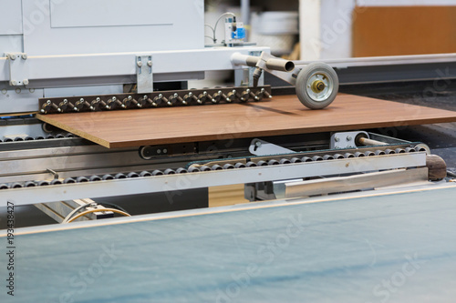 chipboards on conveyer at furniture factory - 193438427