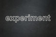 Science concept: text Experiment on Black chalkboard background