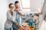 Young couple making breakfast and having fun    - 193442417