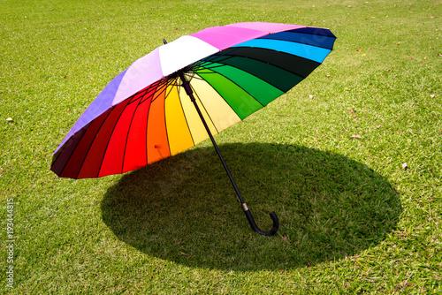 Foto op Aluminium Shanghai rainbow umbrella in grass field vintage and retro tone, soft focus
