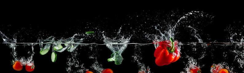 group of vegetables in water splash