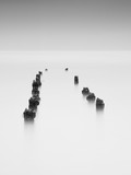 Damaged wooden poles of an old pier in the ocean. - 193449412
