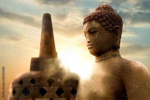 Staande foto Boeddha Borobodur Temple. Statue of Buddha against the background of the sunrise. Java island. Indonesia. Famous historical place. Outside.
