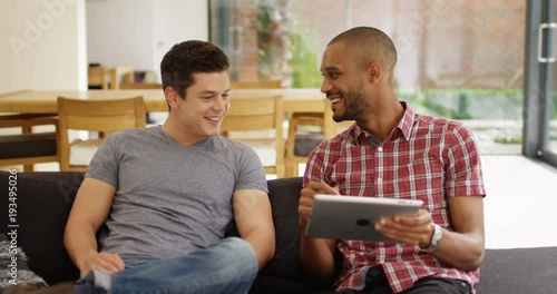 Foto op Aluminium Milkshake 4k, Young couple using a digital tablet together while relaxing on a sofa during daytime.