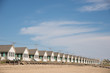 A row of cottages along a sandy beach