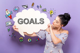Goals with young woman holding a speech bubble - 193511273