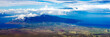 Visually stunning panorama of the northwestern half of Maui, including the dormant volcano Puu Kukui, as seen from the summit of the other volcano on the island, Haleakala