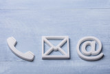 High Angle View Of Phone, Email and Post Icons