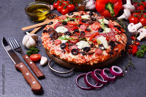 Excellent Italian pizza with cheese and tomatoes, and olives