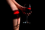 beautiful sexy girl with a glass of wine on a  black-background