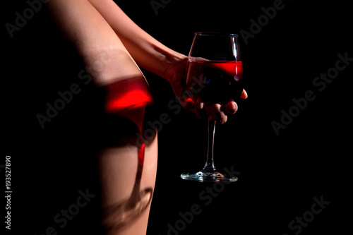 beautiful sexy girl with a glass of wine on a  black-background - 193527890