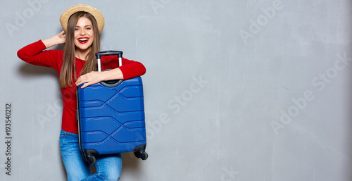 Smiling happy woman with travel suitcase.