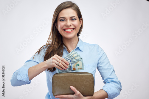 Portrait of happy woman holding cash money with purse.
