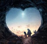 Christmas religious nativity concept: Silhouette mother Mary and father Joseph looking Jesus born in birth manger on Christmas Eve - 3d illustration