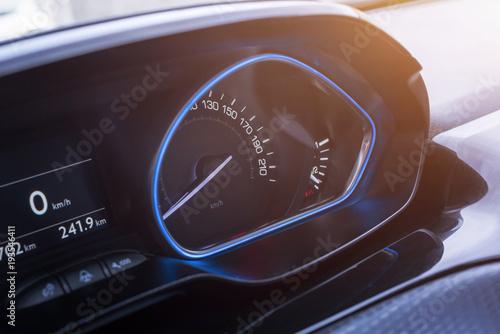 Poster Car speedometer close up. Modern blue interior design.
