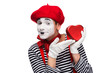 happy mime showing at heart shaped gift box isolated on white, st valentines day concept