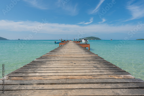 Plexiglas Thailand Wooden pier with boat in Phuket, Thailand. Summer, Travel, Vacation and Holiday concept.